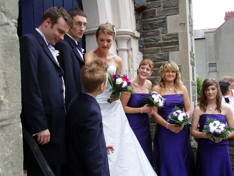 Frances and Meilyr plus bridesmaids and pageboys, at the church door